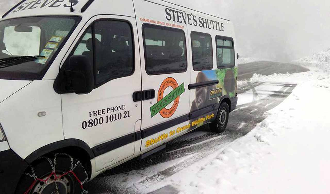 Van on snowy road Photo